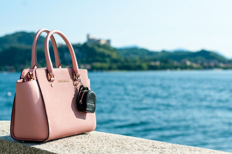 Pink anti theft travel bag by the lake