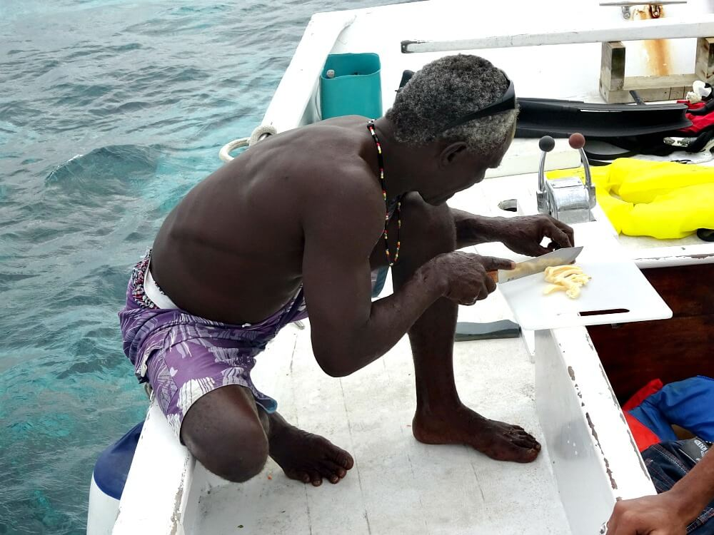 Making conch ceviche on snorkeling tour