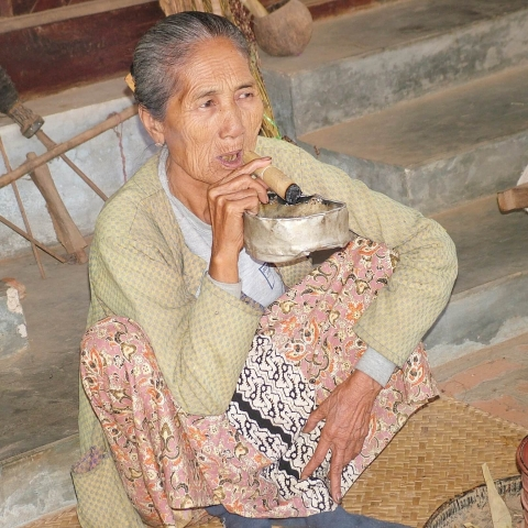 old woman with cigar