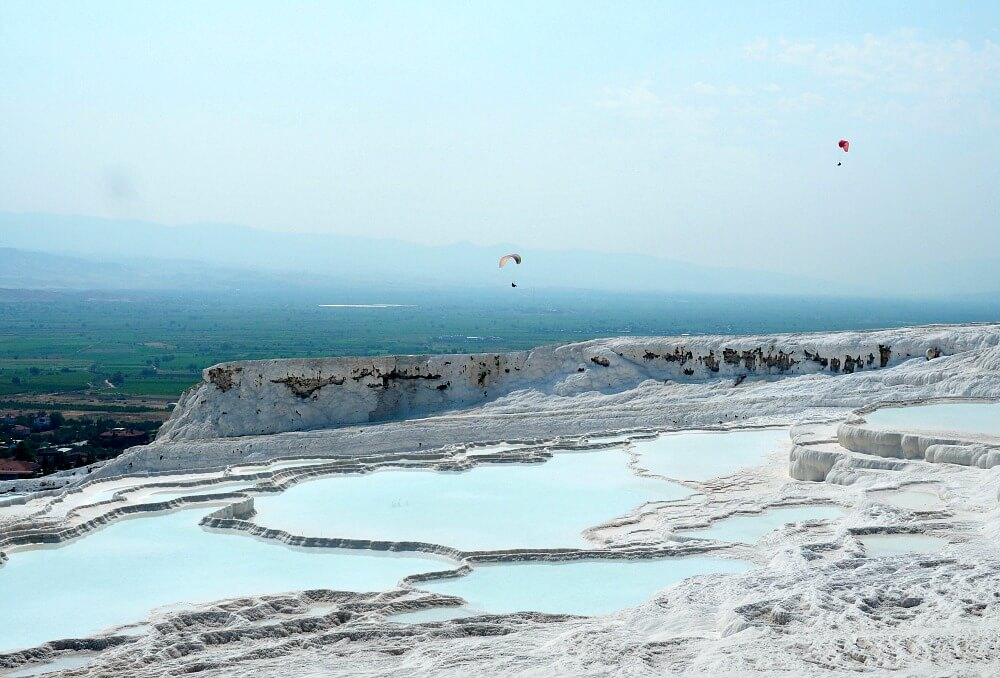 Paragliders over Pamukkale's travertines