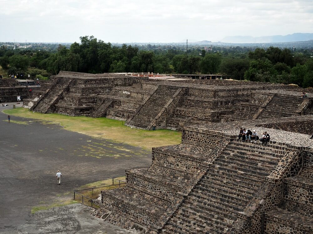 Men sitting on platform at Teotihuacan