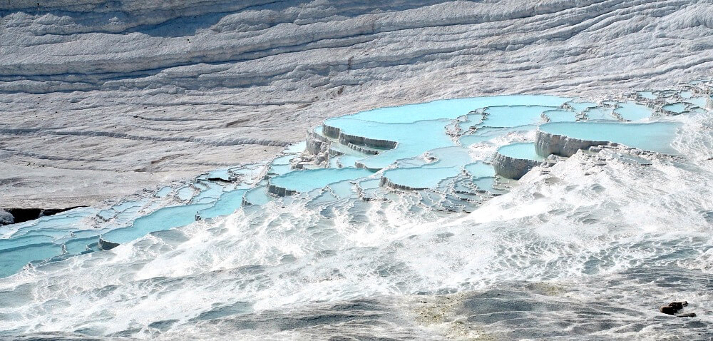 Pamukkale travertines with pools of aquamarine water