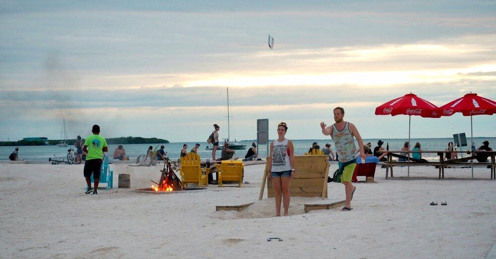 Playing beach games at The Split - Caye Caulker beach