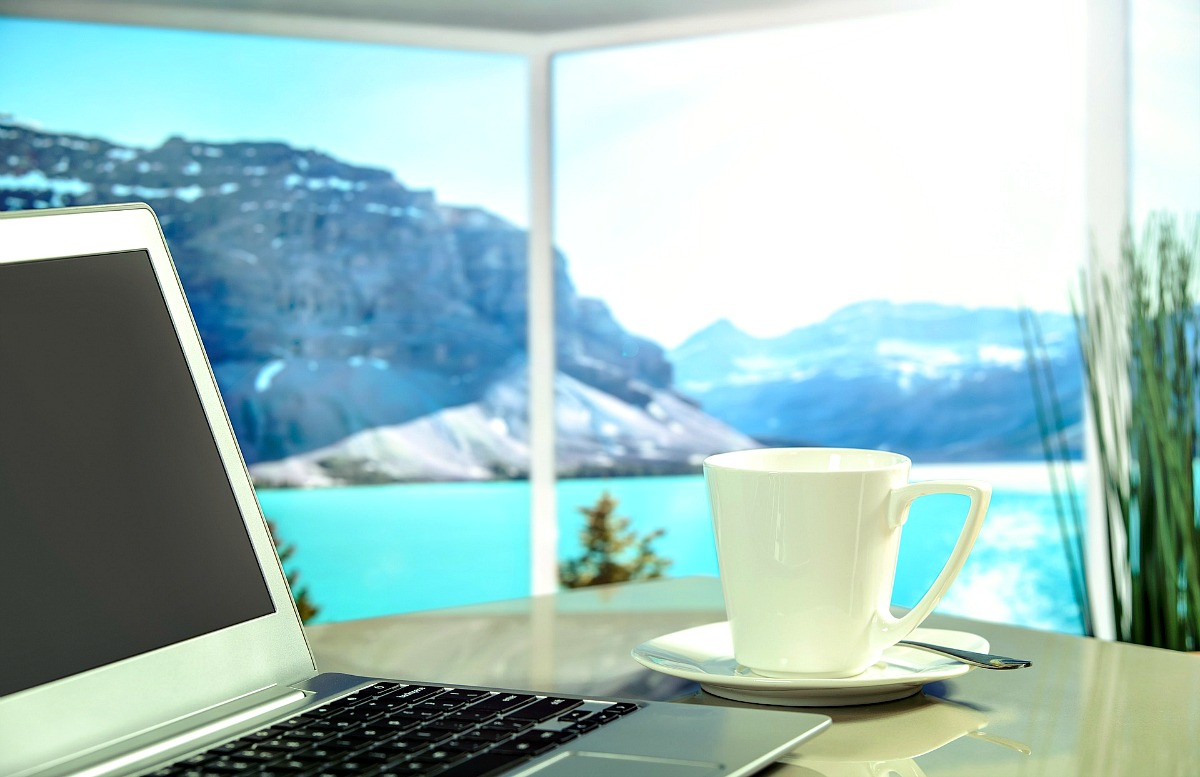 Image of the best laptop for blogging with water view.